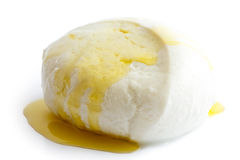Single ball of mozzarella cheese covered with oil, isolated. Royalty Free Stock Image