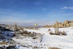 Single ballon rising in cappadocia winter. There is a stable in winter This Turkey Cappadocia royalty free stock photos