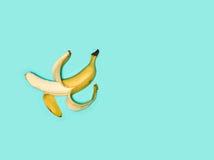 Single banana against blue background Royalty Free Stock Photo