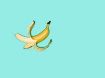 Single banana against blue background Stock Photo