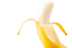 A single Banana peeled down. Ready to eat on a isolated on a white background Royalty Free Stock Image