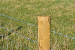 Single barbed wire fence post Royalty Free Stock Images