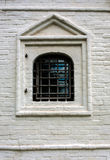Single barred window in brick wall Royalty Free Stock Images
