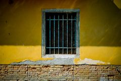 a single barred window in wall Royalty Free Stock Images