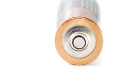 Single battery. Close-up of a used battery with a white background Stock Image
