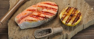 Single BBQ Grilled Salmon Steak On The Wood Board Stock Photos