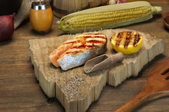 Single BBQ Grilled Salmon Steak On The Wood Board Stock Image