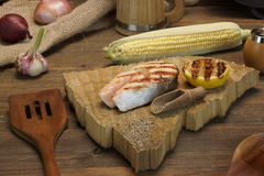 Single BBQ Grilled Salmon Steak On The Wood Board Royalty Free Stock Image
