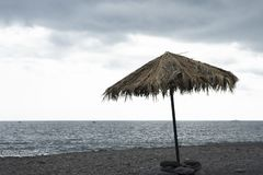 Single beach umbrella on a background of the ocean royalty free stock photography