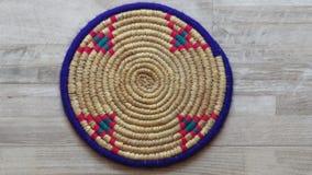 Northern Iran handicraft. Beautiful Handmade Woven Bamboo / Cane Tray. A Single Beautiful Handmade Woven Bamboo / Cane Tray with Colourful Woollen Elements in royalty free stock images