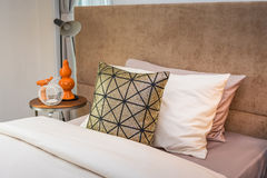 Single bed with bedside table Royalty Free Stock Photography