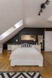 Single bed in elegant bedroom Royalty Free Stock Photos