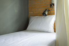 Single bed in hotel Stock Photography