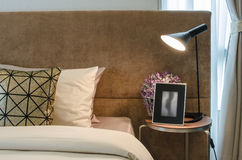 Single bed with lamp on table in bedroom Stock Image