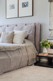 Single bed in modern bedroom with plants on table Stock Photography