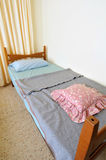 Single bed in motel Stock Photos