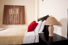 Single bed by a window Royalty Free Stock Image