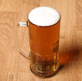 Single beer glass on wooden table Stock Photos