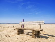 Wooden bench on the beach Stock Photography