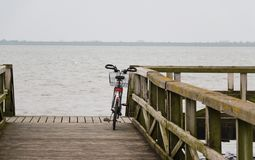 Single bicycle leaning against a railing stock image