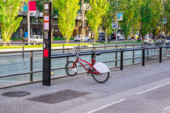Single bicycle  for rent parked on the street in Barcelona. Royalty Free Stock Image