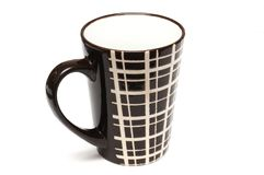 A single big tall dark brown coffee cups with simple lines design stock image