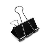 A single binder peg office, isolated on a white background. The black and metallic paper clip. Binder clips or clerical pins for p. Close-up picture of a single stock photos