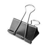A single binder peg office, isolated on a white background. The black and metallic paper clip. Clerical pins for papers. Stock Images