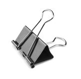 A single binder peg office, isolated on a white background. The black and metallic paper clip. Clerical pins for papers. Close-up picture of a single black and stock photo