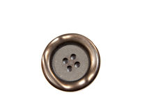 Single black clothing button isolated over the Stock Photo