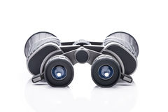 Single black pair of binoculars isolated on a white background Stock Image