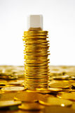 Single blank block over gold coins Royalty Free Stock Photos