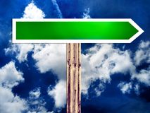 Single blank direction road sign and the sky Royalty Free Stock Image