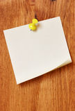 Single blank note paper. Attached to a wooden wall stock images