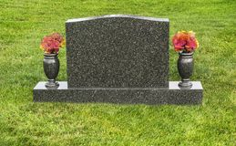 Free Single Blank Tombstone In Cemetery With Flowers Stock Photos - 117249233