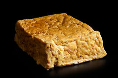 Single block of smoked tofu. Royalty Free Stock Photography