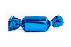 Single blue candy isolated stock image