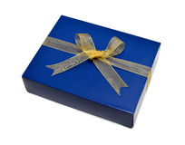 Single blue gift box with gold ribbon and bow Royalty Free Stock Images