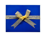 Single blue gift box with gold ribbon and bow Royalty Free Stock Photos
