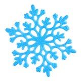 Single blue snowflake on white. Studio close-up of a bright blue snowflake ornament on white background Royalty Free Stock Image