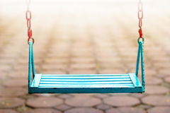 Single blue swing empty people in park and blur background Stock Photo