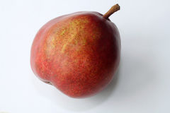 Single blush pear. Single red blush pear on white background Royalty Free Stock Images