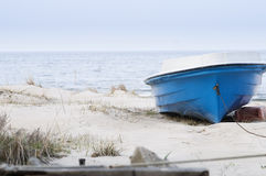 Single boat on the beach stock photos