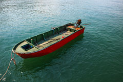 Single boat floating on clear water Royalty Free Stock Photo