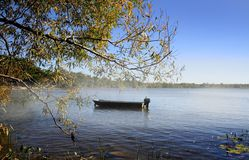 Single Boat On The Lake Stock Photo