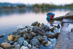 Single boat in Phewa Lake and blurred background. Pokhara Nepal stock photos