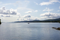 Single boat in a quiet bay. Near kenmare on the wild atlantic way ireland Stock Photography