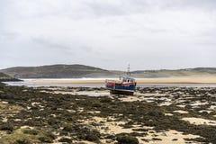 Single boat on a sandy beach