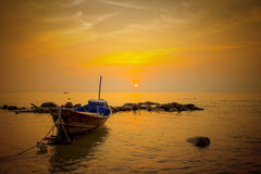 Single boat with sunset silhouette Stock Photography