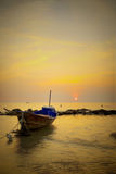 Single boat with sunset silhouette Royalty Free Stock Photo